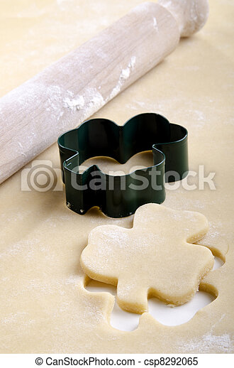 Pastry with cookie cutter with a shamrock shape - csp8292065