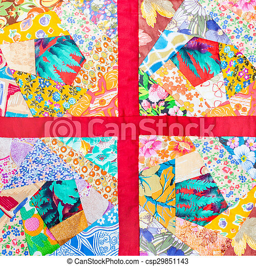 patchwork quilt framed in red cloth - csp29851143