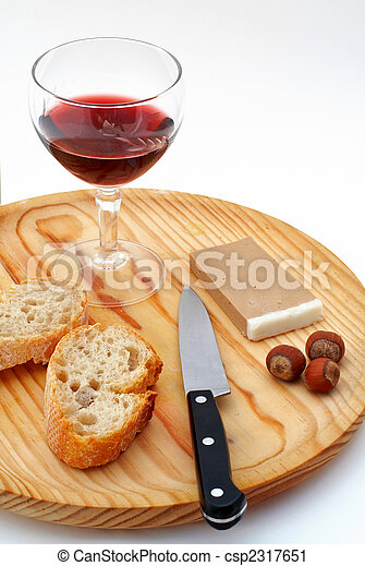 Pate, bread, glass of red wine, hazelnuts and knife a wood plate on white background - csp2317651