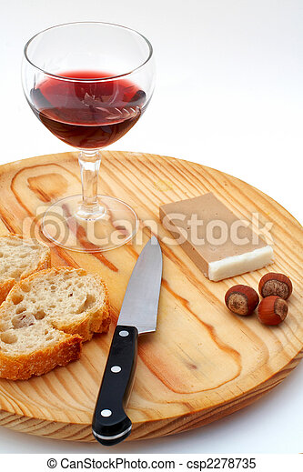 Pate, bread, glass of red wine, hazelnuts and knife a wood plate on white background - csp2278735