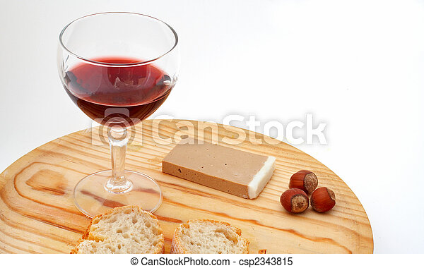 Pate, bread, glass of red wine, hazelnuts on wood plate - csp2343815