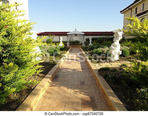 Path in a Green Garden - csp67340729