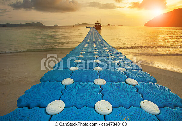 Path Of Floating Pier On Sea Beach Against Beautiful Sun Rising Sky
