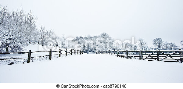 Path through English rurual countryside in Winter with snow - csp8790146