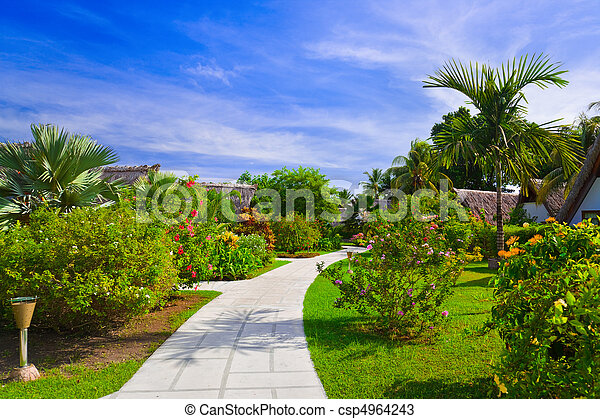 Pathway and bungalows in tropical park - csp4964243