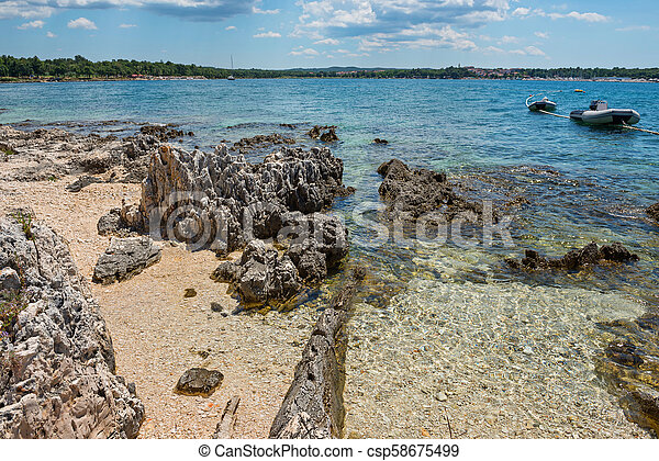 Pathway on the beautiful rocky beach in Istria - csp58675499