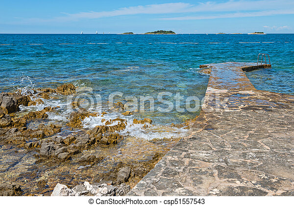 Pathway on the rocky beach in Istria - csp51557543