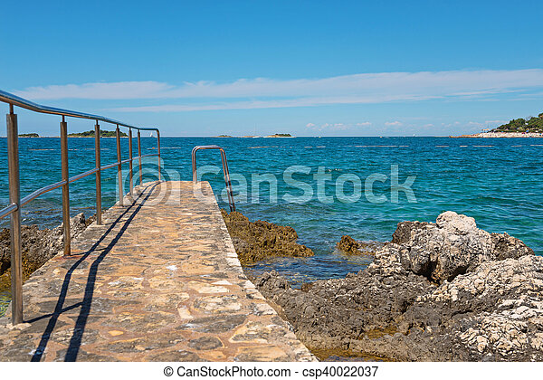Pathway on the rocky beach in Istria - csp40022037