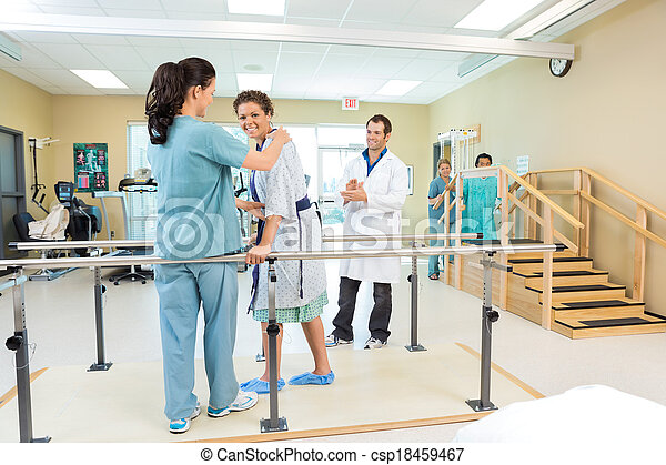 Patient Being Assisted By Physical Therapist - csp18459467