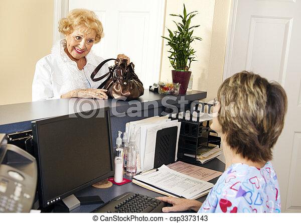 Patient Checks Out - csp3373143