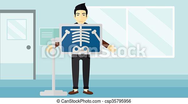 Patient during x-ray procedure. - csp35795956