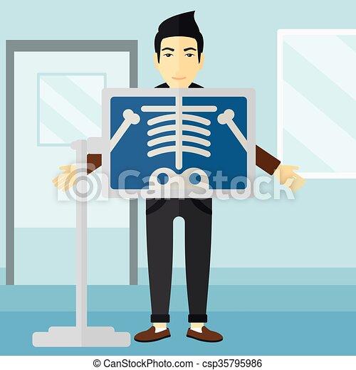 Patient during x-ray procedure. - csp35795986