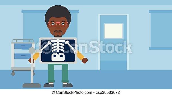 Patient during x ray procedure. - csp38583672