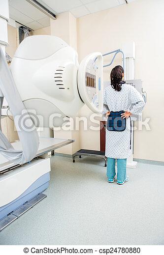 Patient Getting Chest Xray - csp24780880