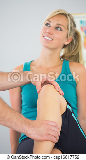Patient having knee examined by physiotherapist - csp16617752