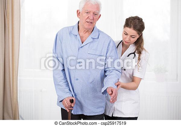 Patient using walking stick - csp25917519