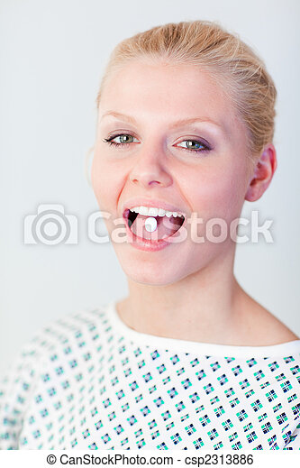 Patient with a pill in her mouth - csp2313886