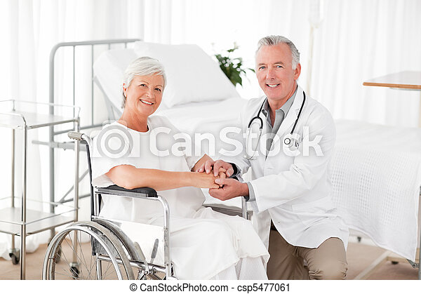 Patient with her doctor looking at the camera - csp5477061
