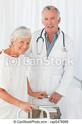 Patient with her doctor looking at the camera - csp5476999