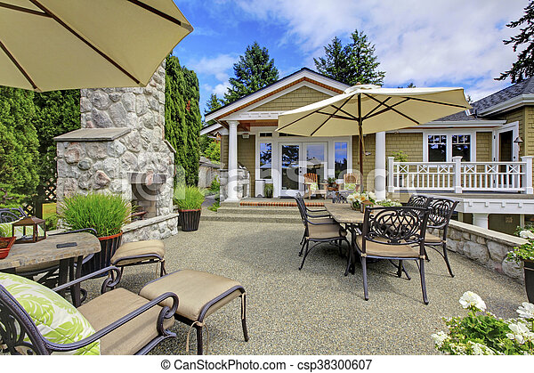Patio area with stone fireplace and concrete floor. - csp38300607