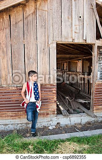 Patriotic boy and old barn - csp6892355