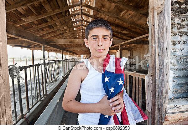 Patriotic boy in old barn - csp6892353