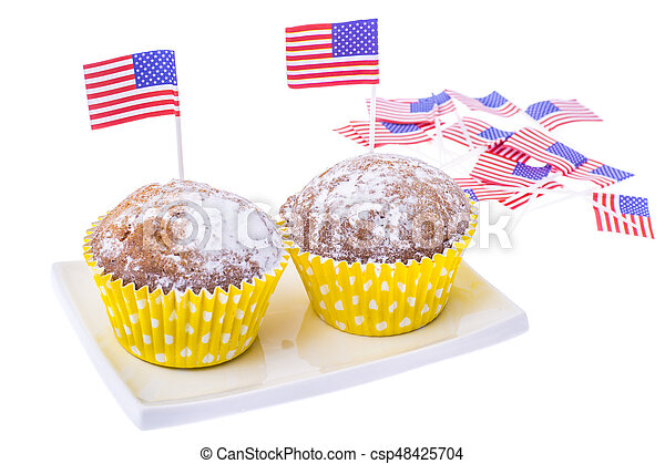 Patriotic holiday 4th of july: cupcakes with American flag. - csp48425704