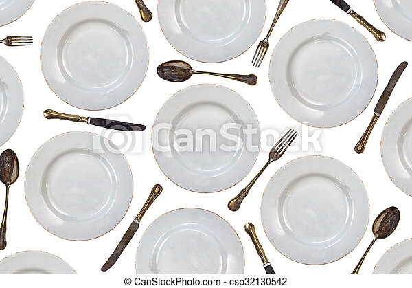 Pattern of vintage dinner plates, knives, forks and spoons - csp32130542