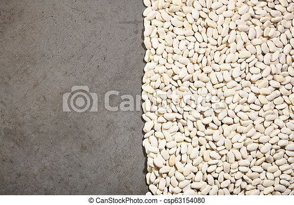 Pattern with white beans on grey background. - csp63154080