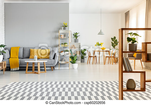 Patterned Carpet And Table In Spacious Apartment Interior With