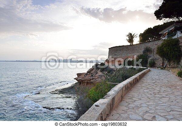 Paved coastal walkway on a summer e - csp19803632