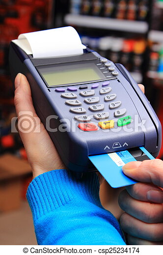 Paying with credit card in an electrical shop, finance concept - csp25234174