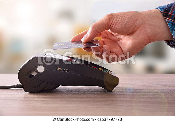 Payment on a trade through contactless card and NFC technology - csp37797773