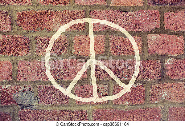 peace sign drawing on red brick wall - csp38691164