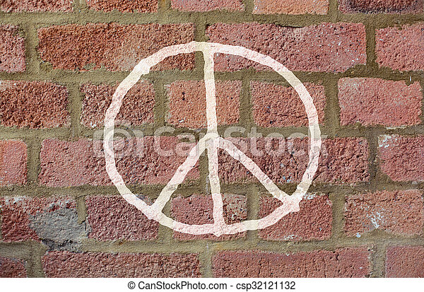 peace sign drawing on red brick wall - csp32121132