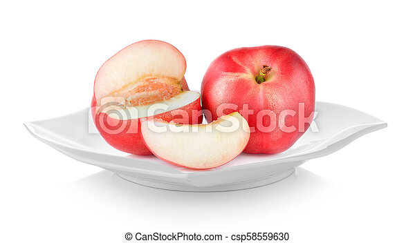 Peach in plate on white background - csp58559630