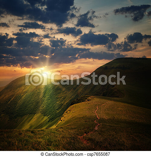 peak of the hill with pathway and mountain sunset - csp7655087