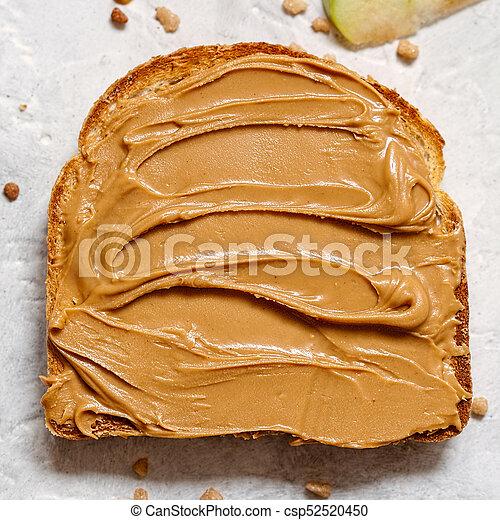 peanut butter on a slice of toast peanut butter spread on a slice
