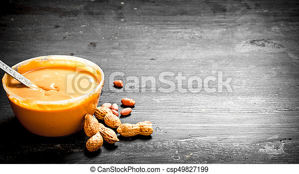 Peanut butter with nuts in a bowl. - csp49827199