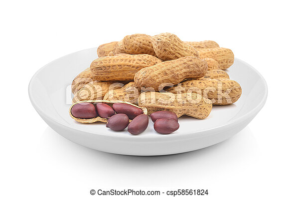 peanuts in plate on white background - csp58561824