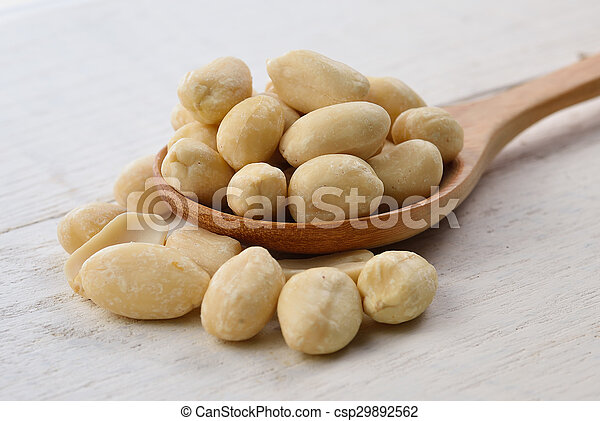 peanuts in spoon on white wooden - csp29892562
