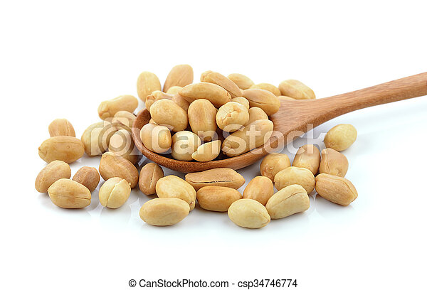 peanuts in the wood spoon on white background - csp34746774