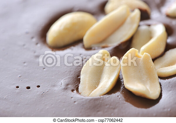 Peanuts on Top of Chocolate Frosting - csp77062442