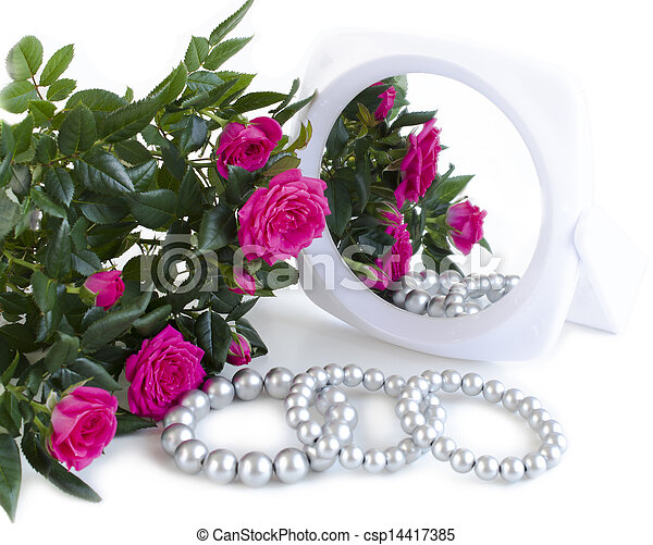 pearl bracelets, bouquet of roses and a mirror - csp14417385