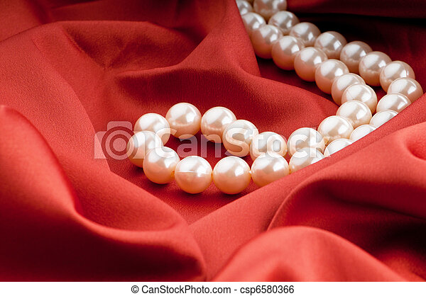 Pearls necklace on satin background - csp6580366