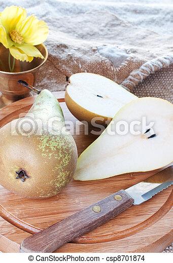 Pears on cutting board - csp8701874
