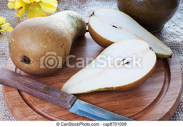 Pears on cutting board - csp8701009