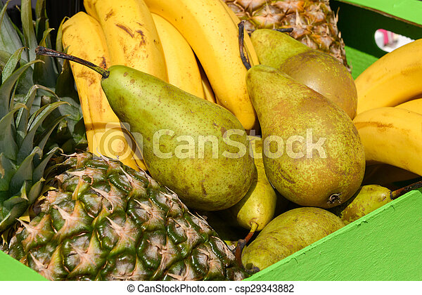 pears pineapples bananas in a wooden box - csp29343882