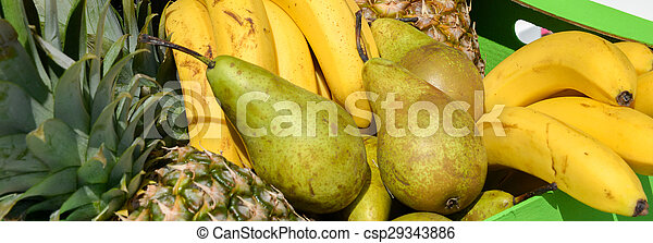 pears pineapples bananas in a wooden box - csp29343886