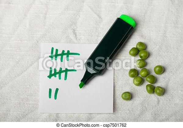 peas and a tally sheet - csp7501762